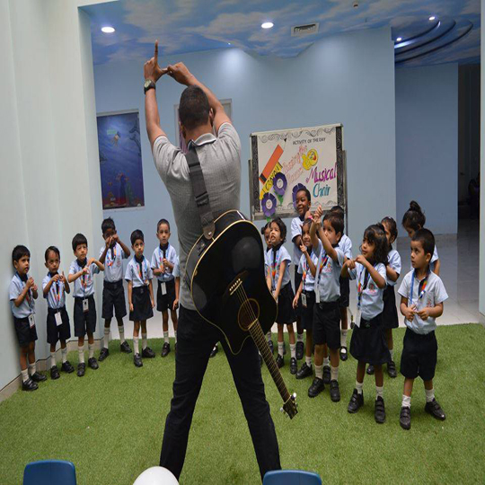 Nursery students learning the art of music